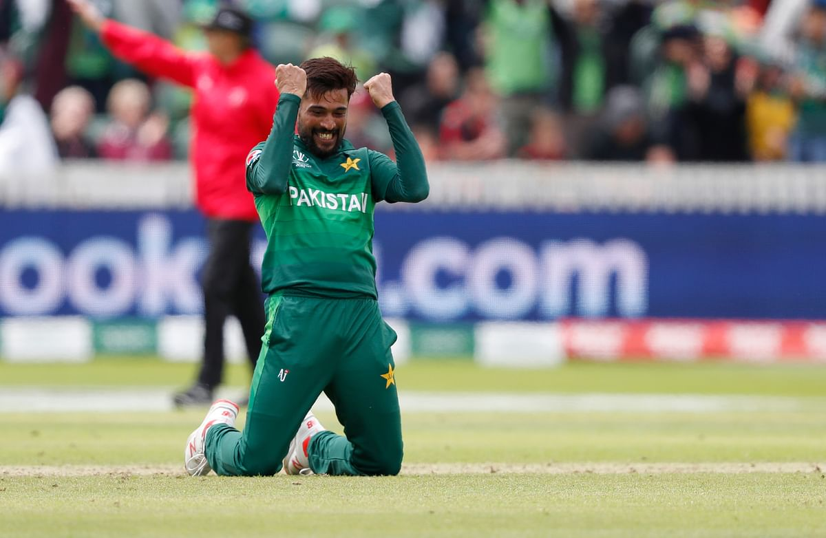 Mohammad Amir celebrates after taking the wicket of Australia's Mitchell Starc.