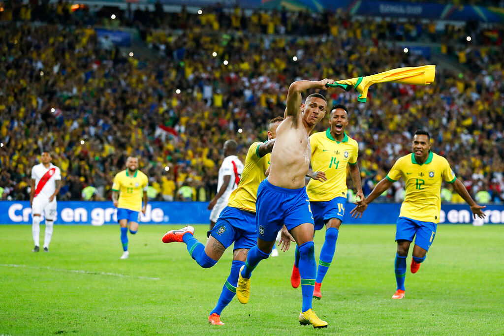 Brazil's Richarlison celebrates with teammates after scoring his side's third goal against Peru during the final soccer match of the Copa America at the Maracana stadium in Rio de Janeiro.