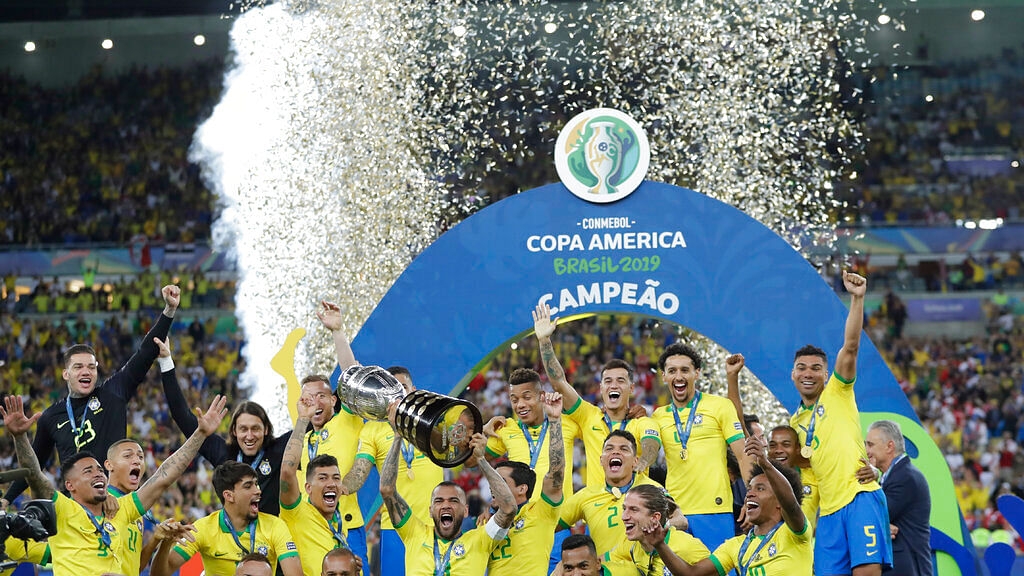 Brazil's team pose with trophy.