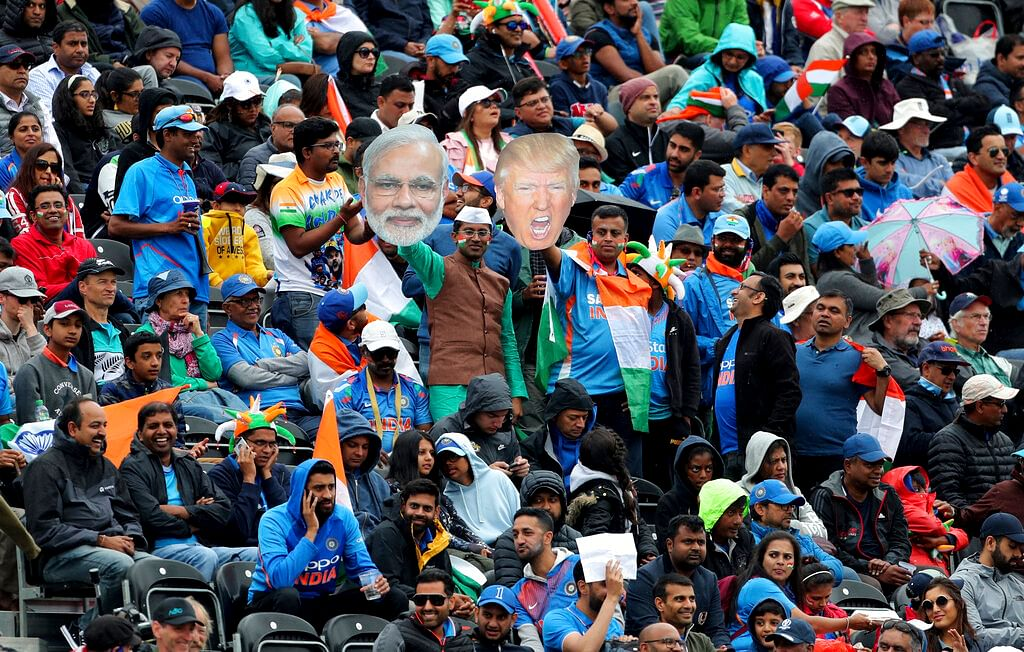 Indian supporters display portraits of U.S. President Donald Trump and Indian Prime Minister Narendra Modi during the Cricket World Cup semi-final match between India and New Zealand at Old Trafford in Manchester.