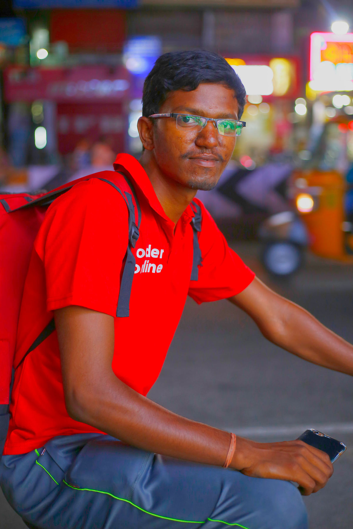 A college student delivering food by cycle for livelihood