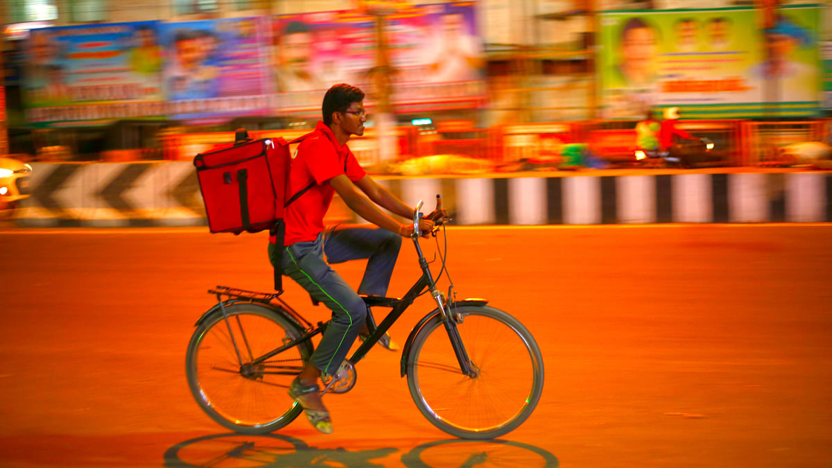 Raghunath delivering food by cycle.