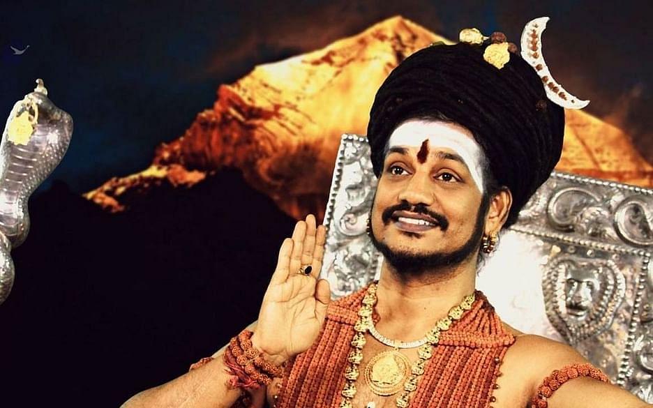 `நித்யானந்தா ஆன்மிக சுற்றுலாவில் இருக்கிறார்!'  - நீதிமன்றத்தில் கர்நாடக போலீஸார்