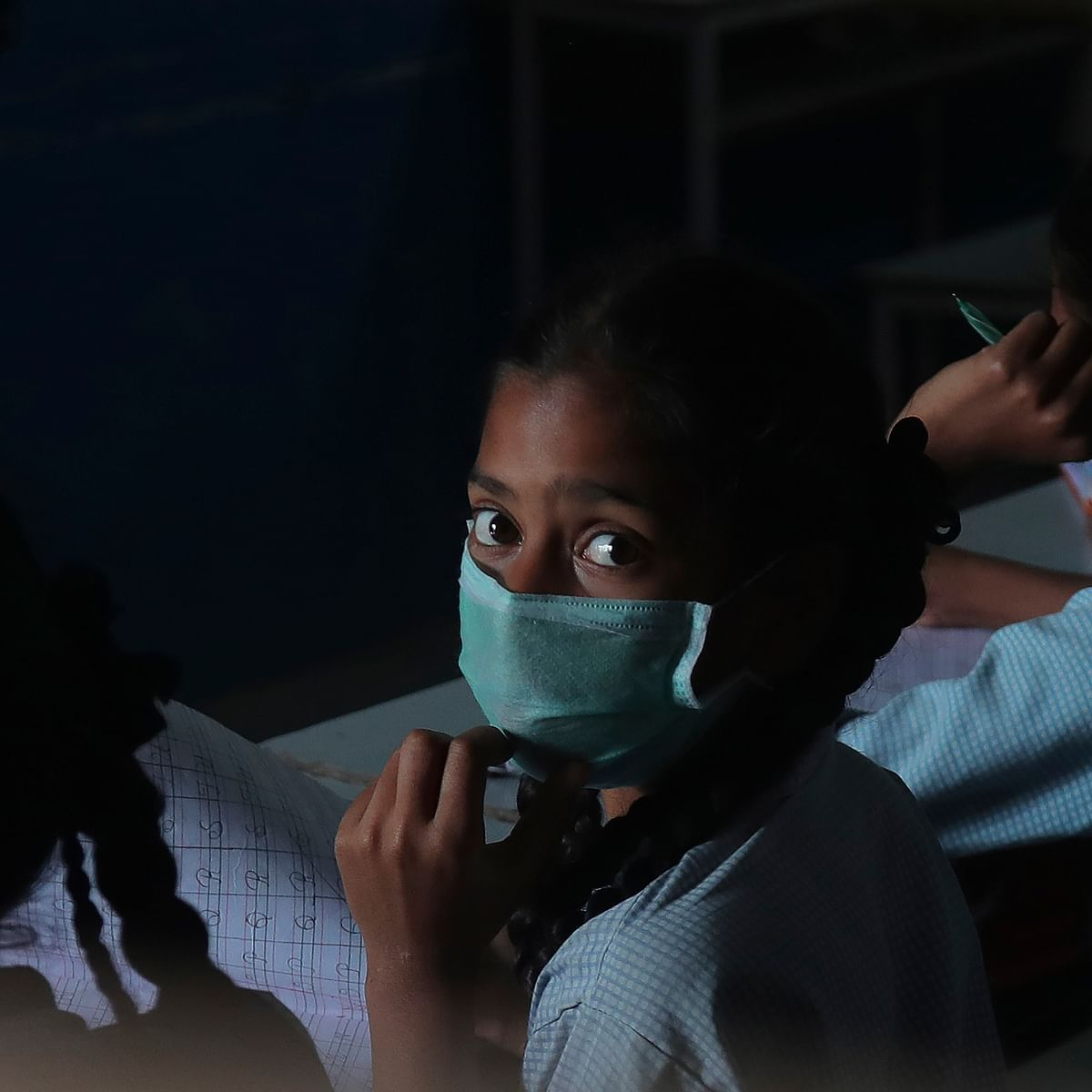 Girl wearing mask to protect from Covid - 19