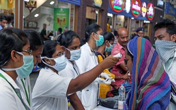 `கண்காணிப்பில் 59,295 பேர்; ஆட்சியர்களுக்கு அதிகாரம்!' கேரளாவைத் தொடர்ந்து அச்சுறுத்தும் கொரோனா