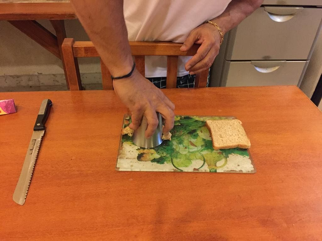 Cut the bread into shape using  a tumbler.