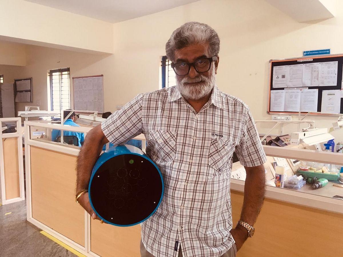 Scientist Rajah Vijay Kumar with the device