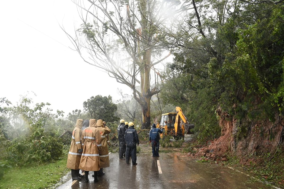 Fire and rescue service personnel clear roads.