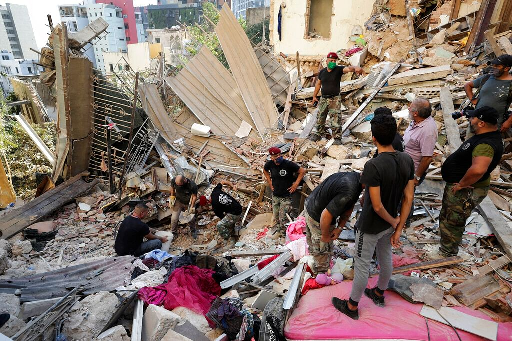 Lebanese soldiers search for survivors after a massive explosion in Beirut, Lebanon