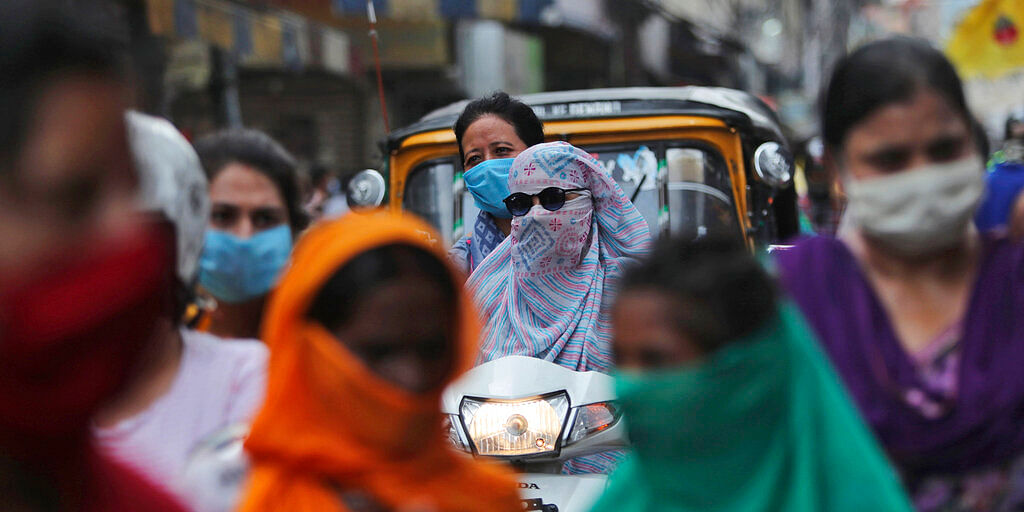 People wearing masks as a precaution in Jammu