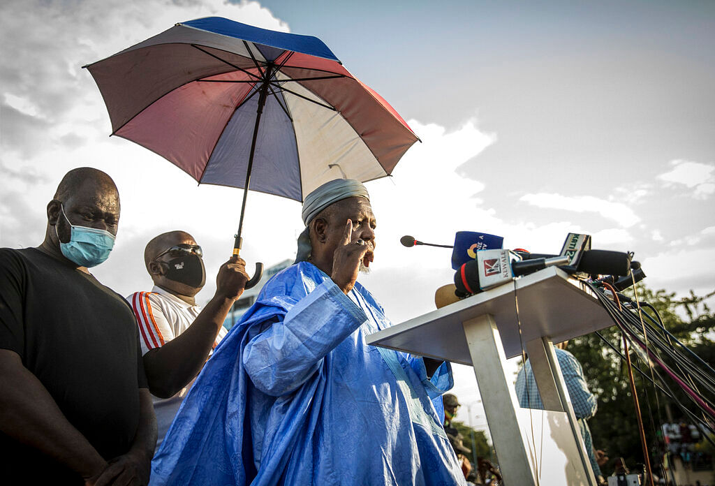 Mahmoud Dicko, an imam who has helped lead the movement against President Ibrahim Boubacar Keita, addresses Malians supporting the recent overthrow of Keita as they gather to celebrate in the capital Bamako, Mali Friday, Aug. 21, 2020.
