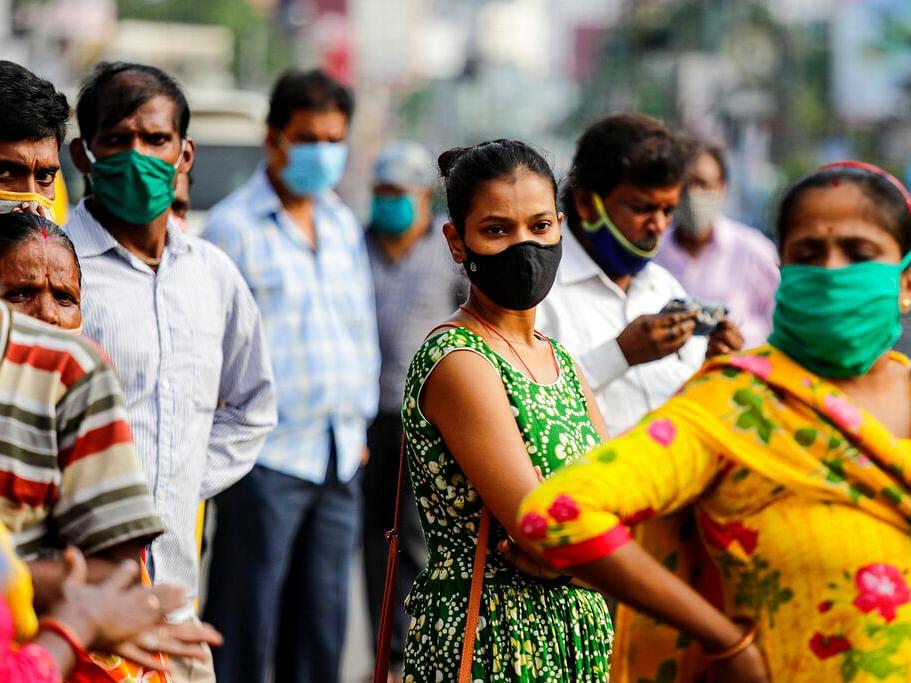 Commuters with face mask | முகக்கவசம்