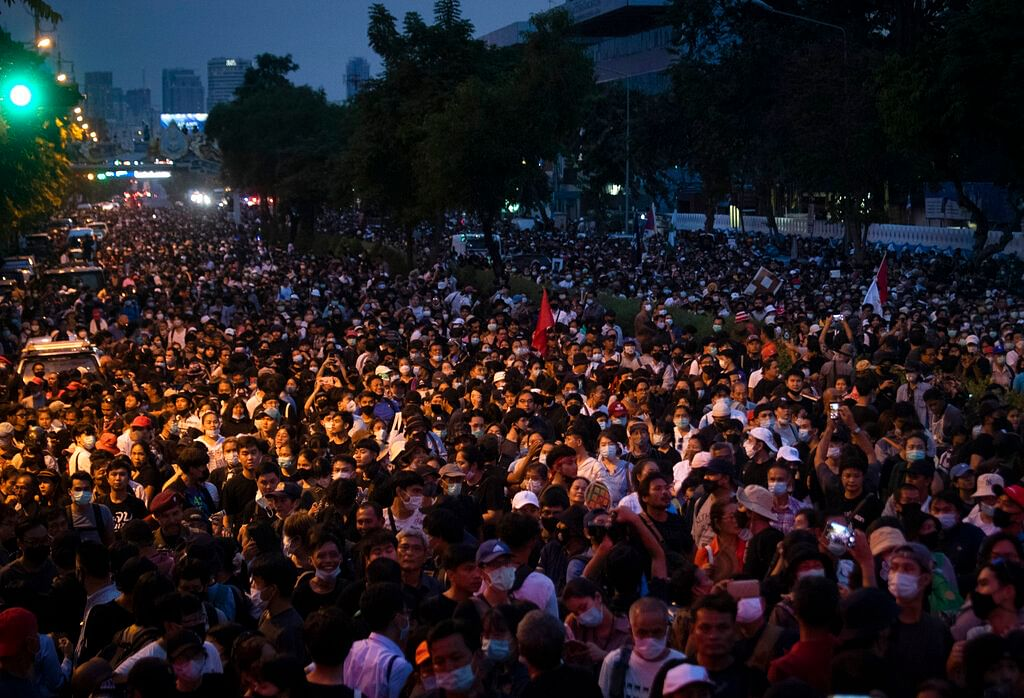 Thousand of pro-democracy protesters gather outside the Government House during a rally in Bangkok, Thailand