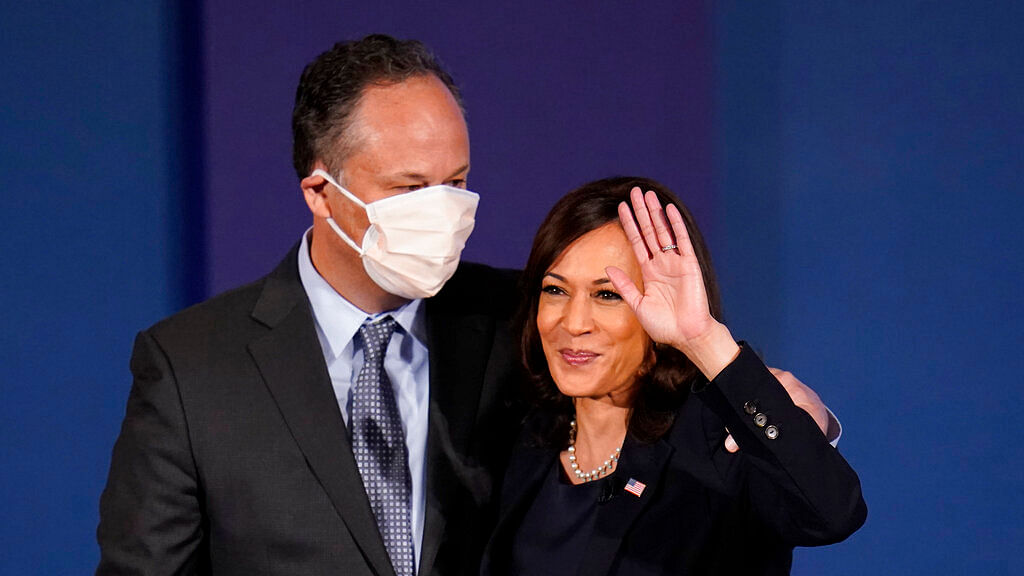 Kamala Harris, waves with her husband Douglas Emhoff