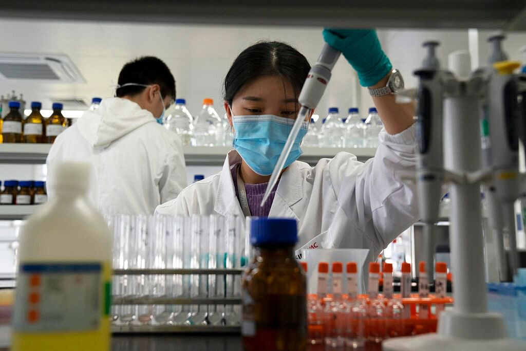 file photo, an employee of SinoVac works in a lab at a factory producing its SARS-CoV-2 vaccine for COVID-19 named CoronaVac in Beijing.