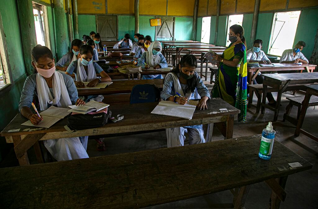 Students attend classes as schools in north-eastern Assam state reopen after being closed for months due to the coronavirus pandemic in Gauhati, India