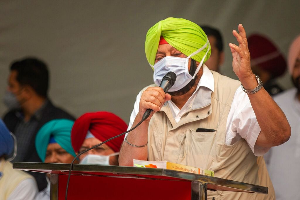 Chief Minister of Punjab state Amarinder Singh addresses a gathering during a protest against