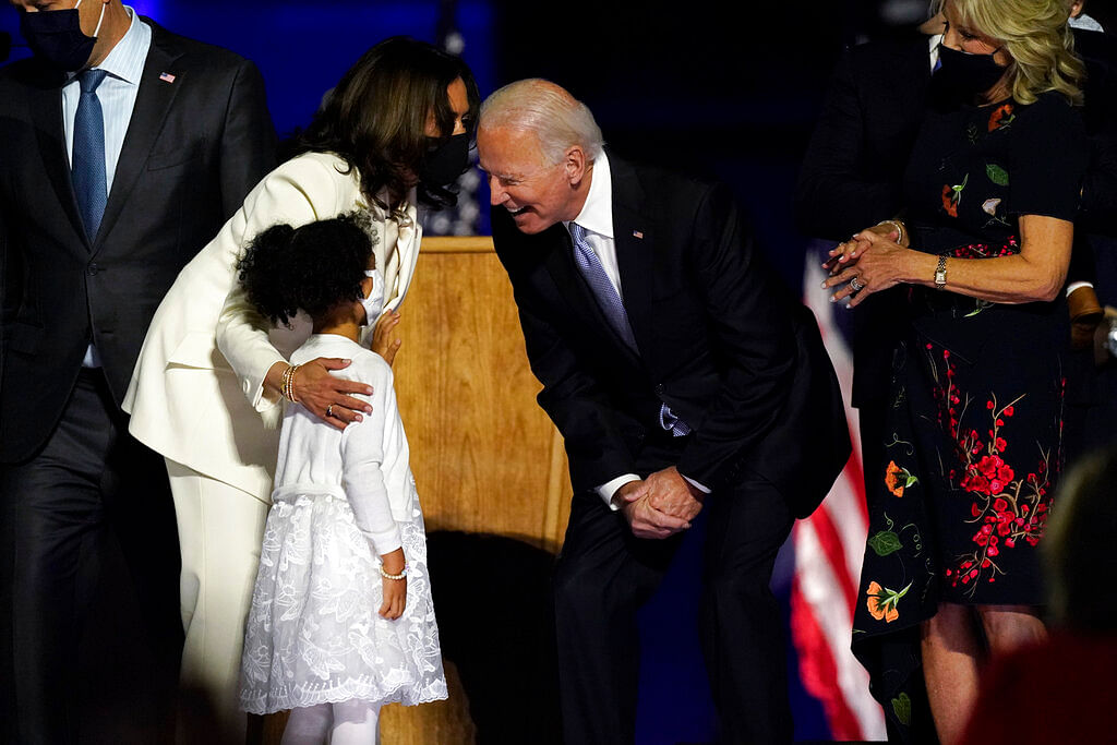 Vice President-elect Kamala Harris and President-elect Joe Biden stand on stage with family