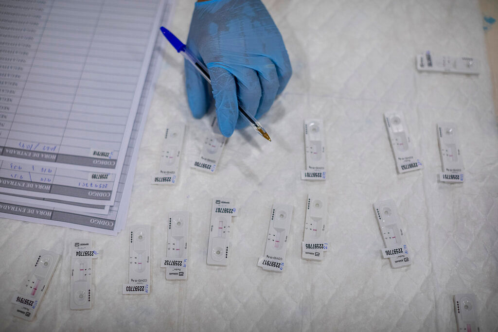 A Madrid Emergency Service (SUMMA) health worker conducts a rapid antigen test for COVID-19 in the southern neighbourhood of Vallecas in Madrid, Spain