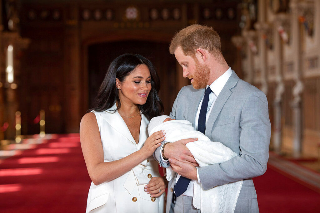 Harry and Meghan holding their son Archie