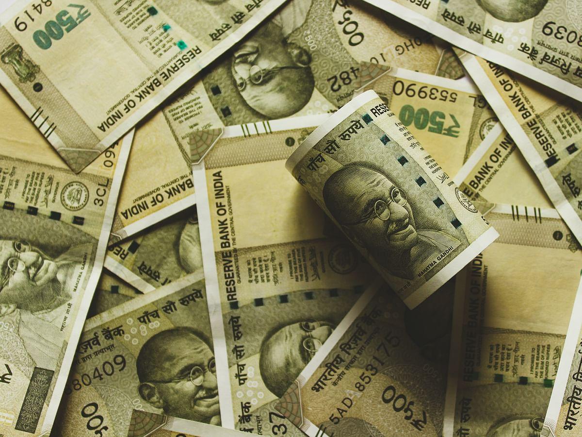 குறைந்த ₹2000, ₹100 நோட்டுகளின் பணப்புழக்கம்; ஆர்.பி.ஐ அறிக்கை சொல்வது என்ன?