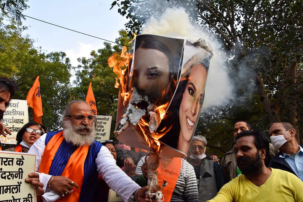 burn portraits of Meena Harris, niece of U.S. Vice President Kamala Harris, and Greta Thunberg in New Delhi, India,