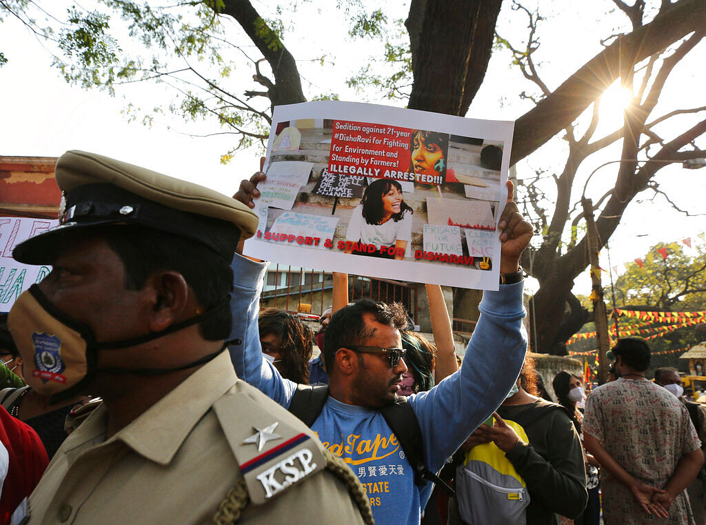 A man holds a placard demanding the release of Indian climate activist Disha Ravi, during a protest in Bengaluru