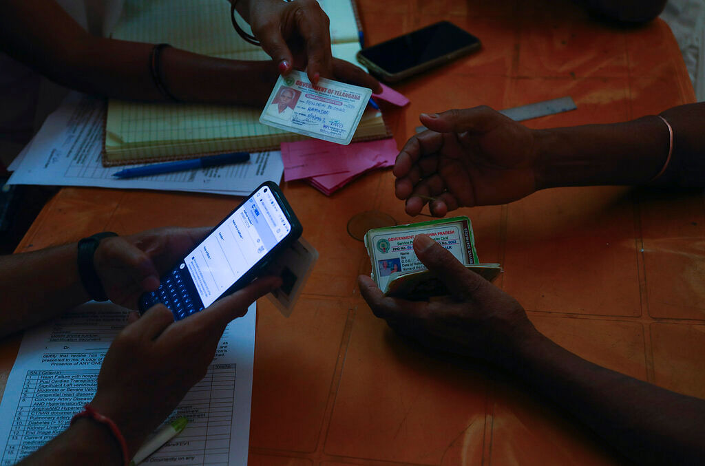 People register their names to receive COVISHIELD vaccine at a government hospital in Siddipet, Telangana state, India