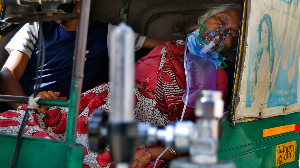 A COVID-19 patient wearing oxygen mask