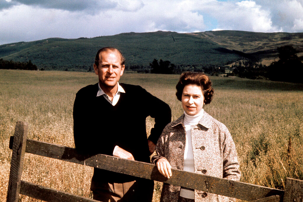 Sept. 1, 1972 file photo, Britain's Queen Elizabeth II and Prince Philip pose at Balmoral, Scotland, to celebrate their Silver Wedding anniversary.
