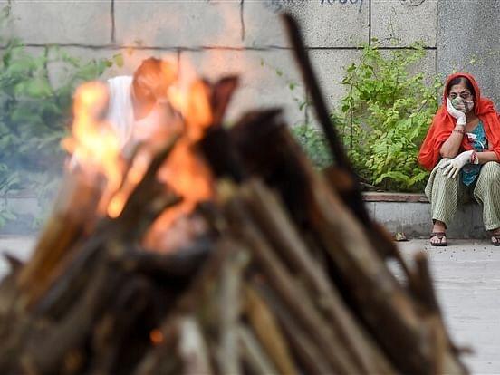 கொரோனா: இந்தியாவில் ஒரே நாளில் 6,148-ஆக அதிகரித்த மரணங்கள்! - காரணம் என்ன?