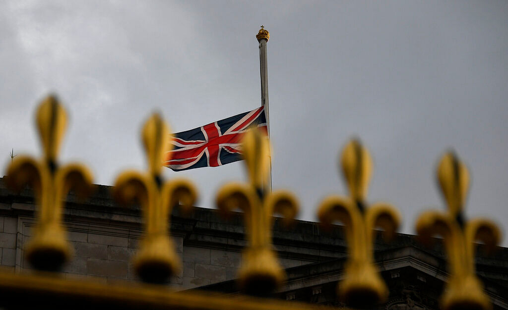 The Union flag waves in the wind at half staff over Buckingham Palace in London, Friday, April 9, 2021.