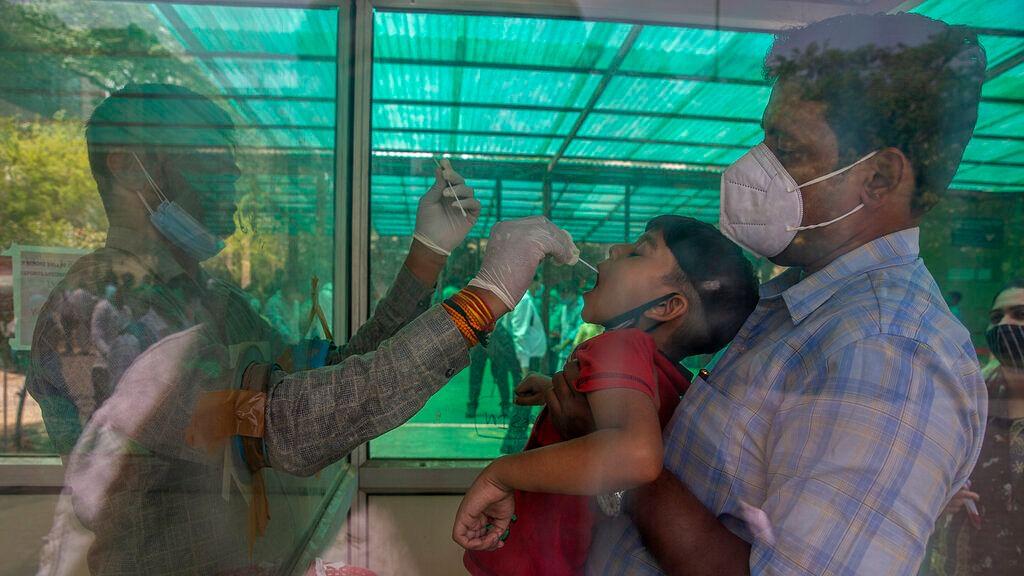A health worker takes a swab sample