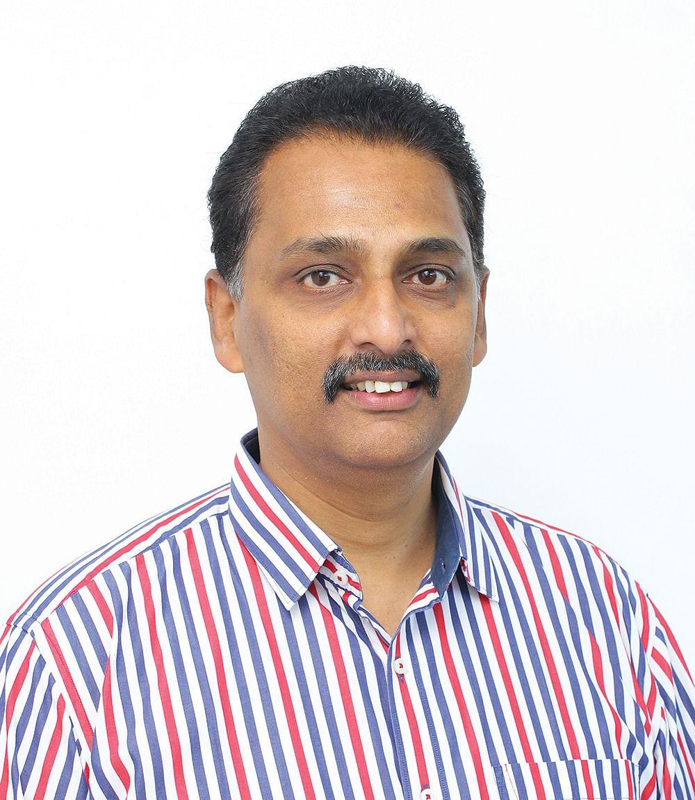 ரெஜி தாமஸ்  பங்குச் சந்தை  நிபுணர்