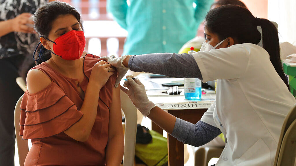 A woman receives the vaccine