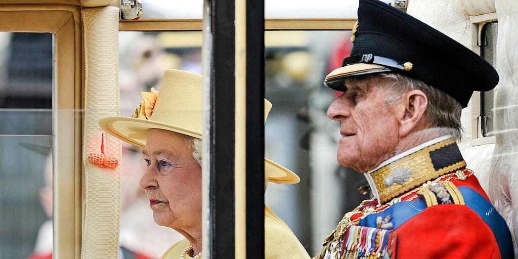 Britain's Prince Philip sits beside Queen Elizabeth II