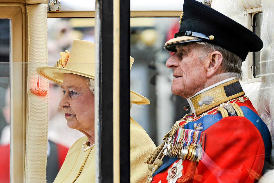 Britain's Prince Philip sits beside Queen Elizabeth II