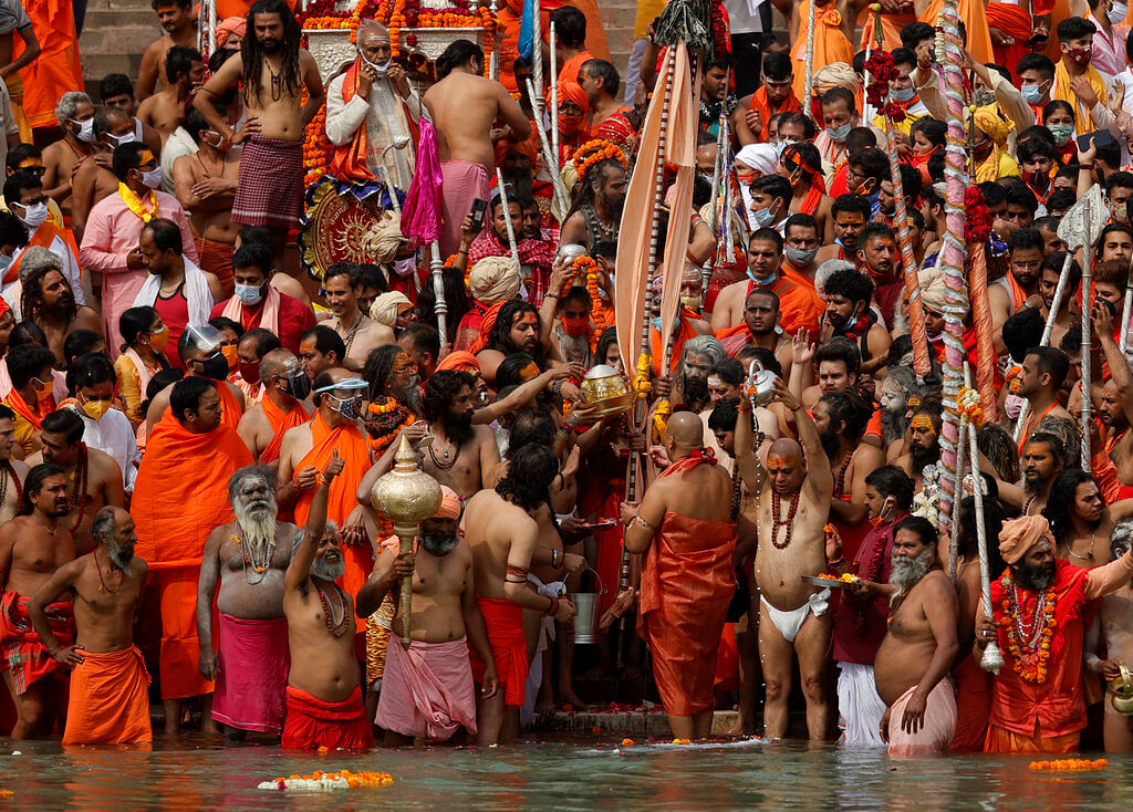 Hindu devotees gather to take holy dips in the Ganges River during Kumbh Mela