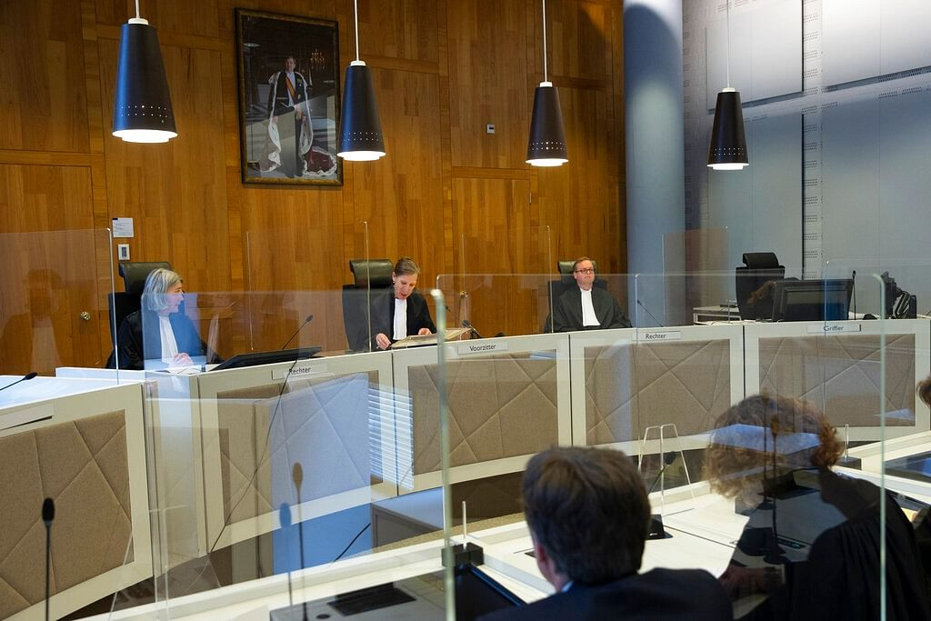 Presiding judge Larissa Alwin, center, reads the verdict as judges Irene Kroft, left, and M.L. Harmsen, right, attend, in the court case of Milieudefensie, the Dutch arm of the Friends of the Earth environmental organization, against Shell in The Hague, Netherlands.