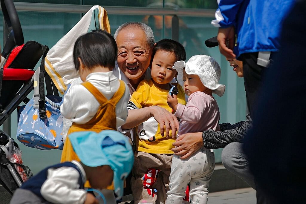 Old man playing with kids