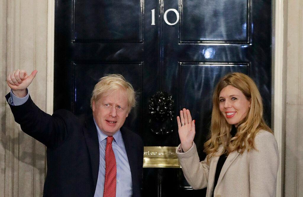 Britain's Prime Minister Boris Johnson and his partner Carrie Symonds