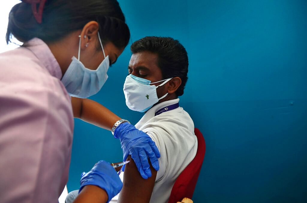 A health worker administers the vaccine