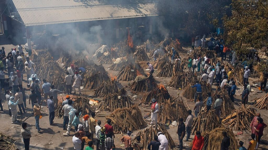 multiple funeral pyres of those who died of COVID-19