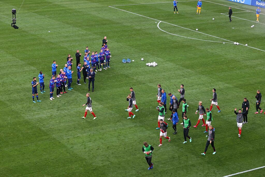 Denmark players returning to the field