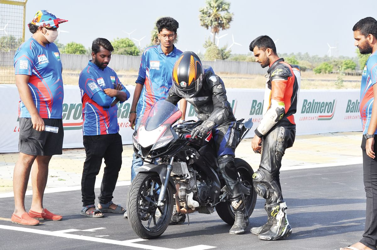 Rider sharing his inputs on handling and brakes to team management participants