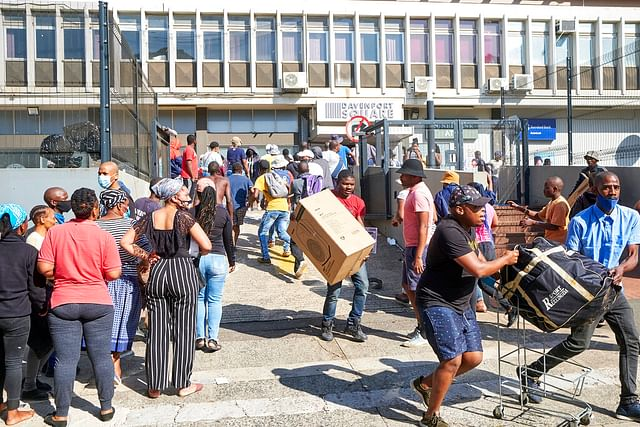 Looters make off with goods at a store in Durban, South Africa