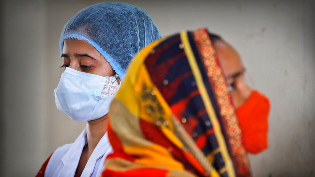 A health worker prepares to administer the vaccine