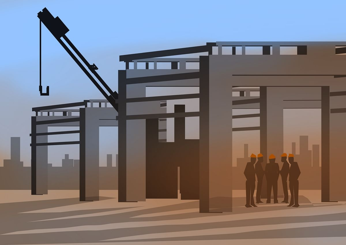 Bharath having a stand-up meeting at the factory construction site with his team