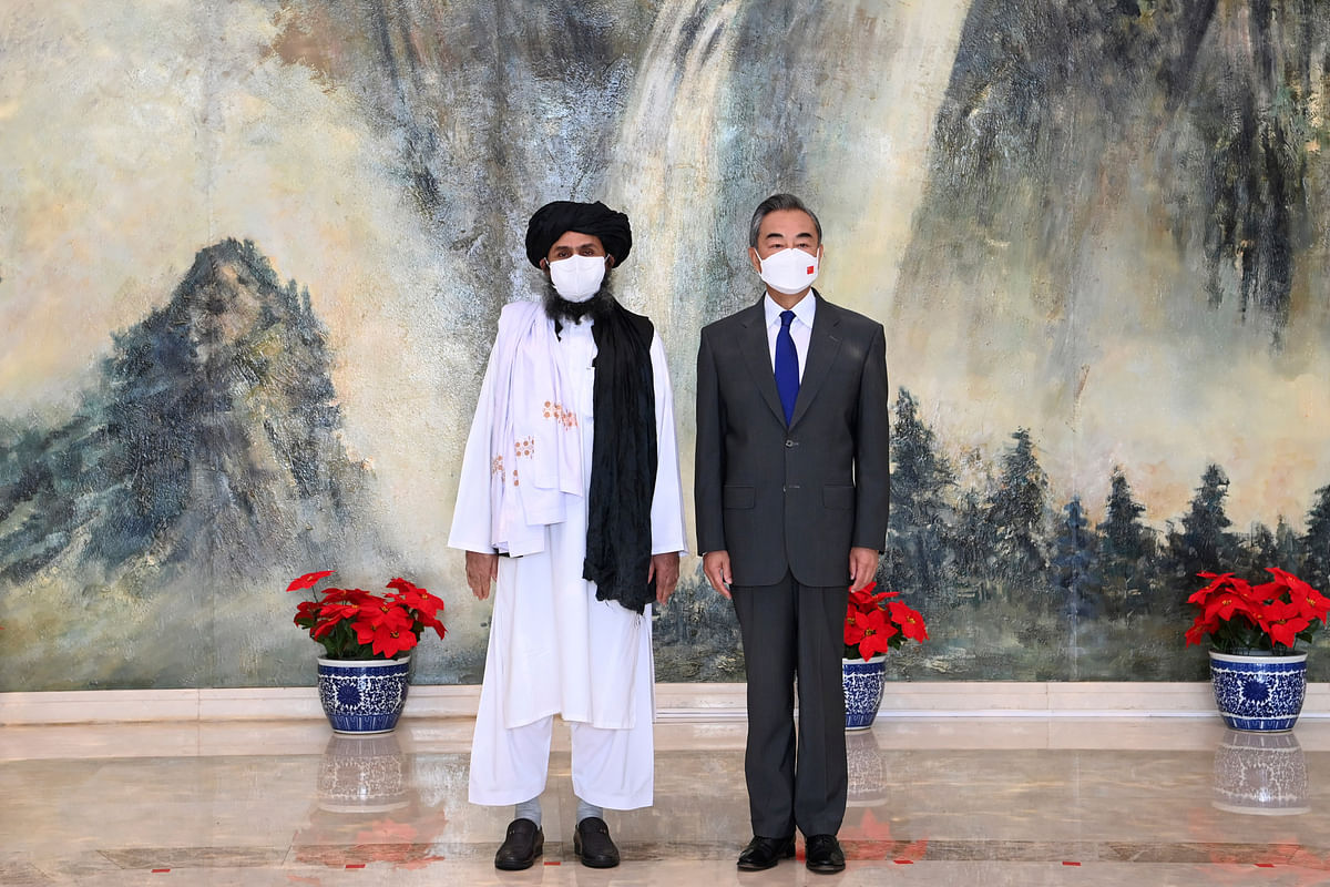 China & Afghanistan | Taliban co-founder Mullah Abdul Ghani Baradar, left, and Chinese Foreign Minister Wang Yi, Right