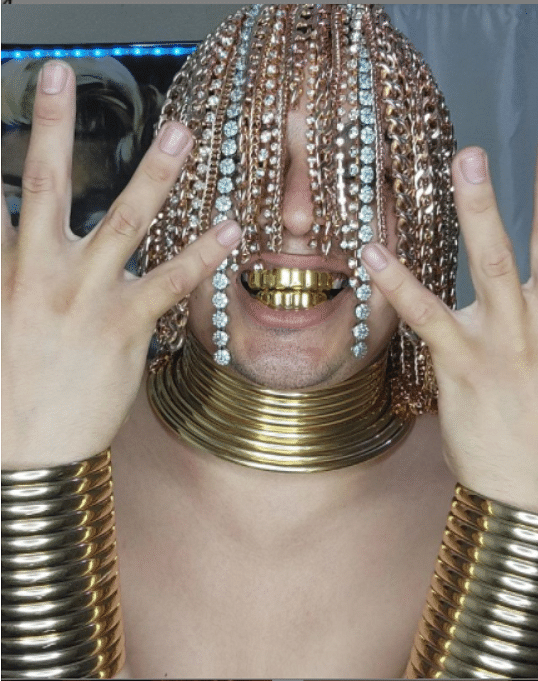 Rapper Dan Sur surgically implants gold chains into his head